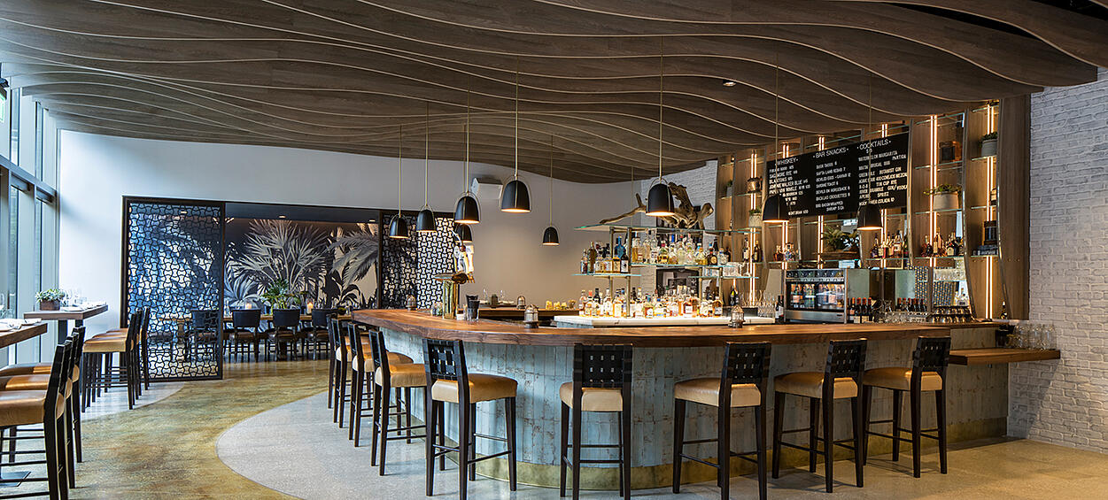 The River Oyster Bar - Bar looking to Private Dining with lighting and wood ceiling detail
