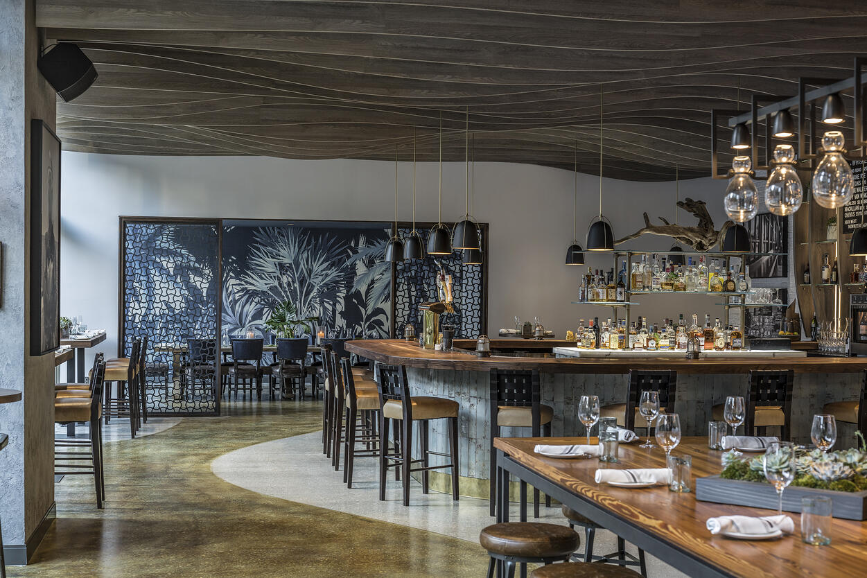 The River Oyster Bar with communal table and bar
