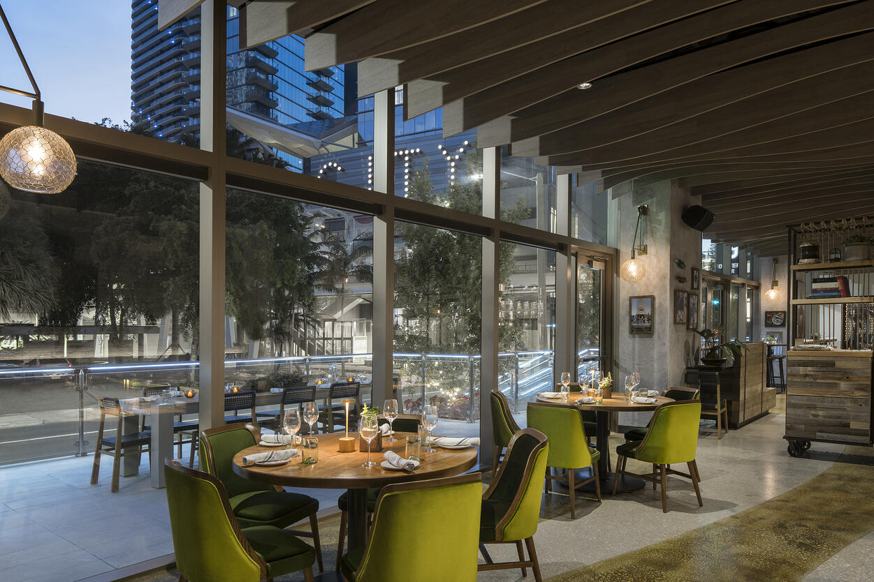 River Oyster Bar dining tables looking out to Brickell City Center