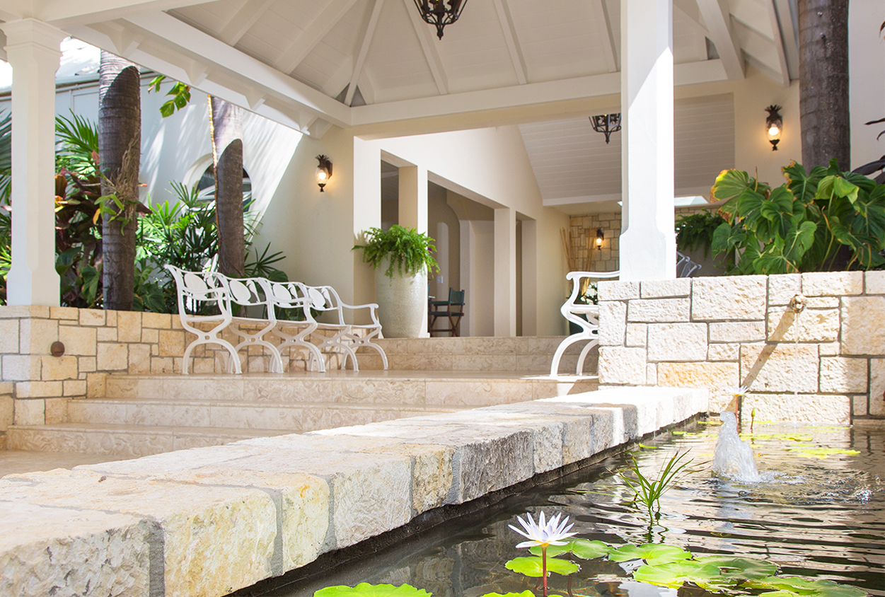 Front entrance seating and water fountain at Curtain Bluff