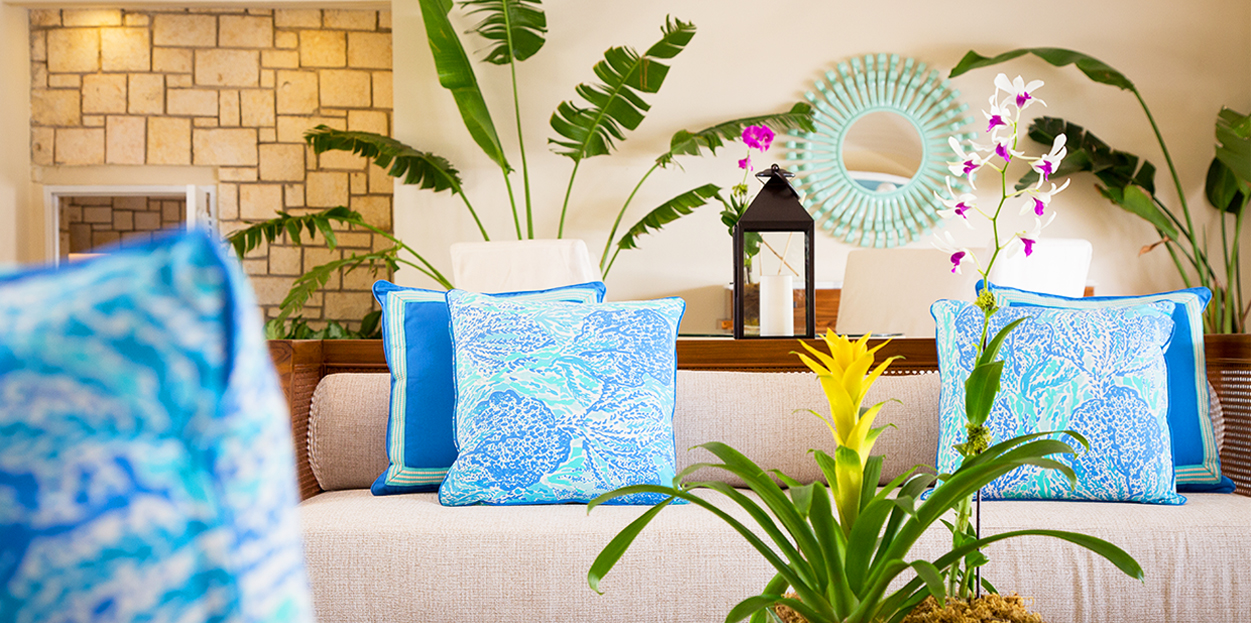 Seating with blue cushions at Curtain Bluff