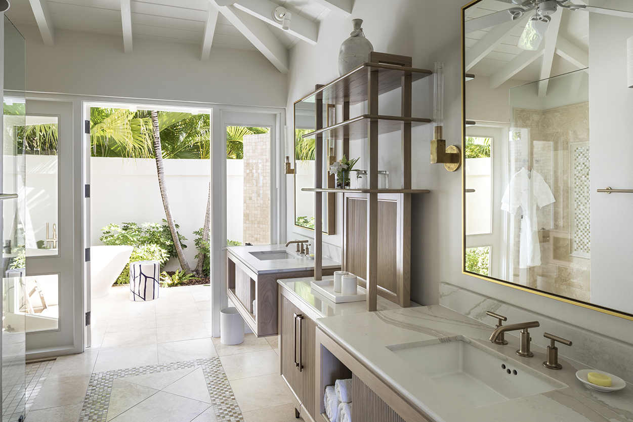 Jumby Bay Pond Bay Suites Ensuite Bathrooms with double vanities and etagere looking to outdoor shower and bath tub