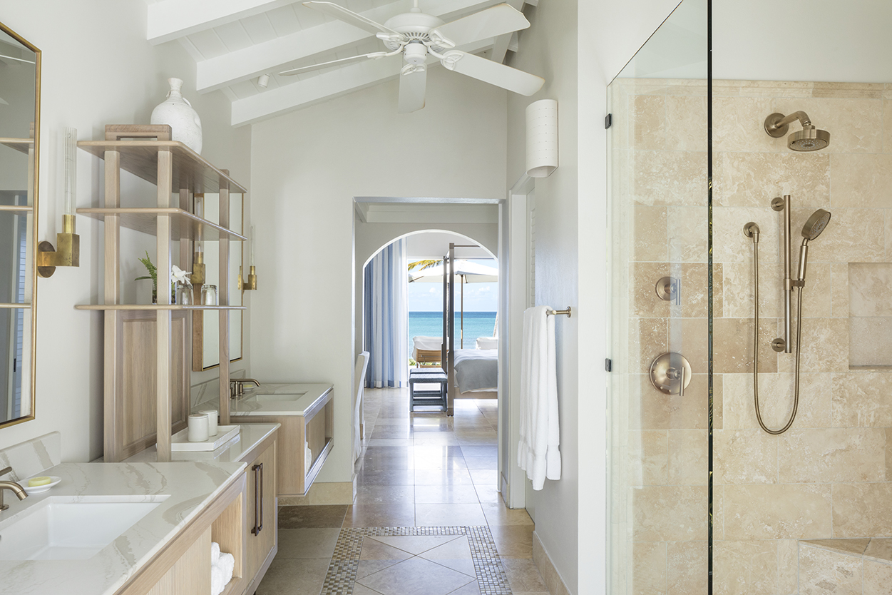 Jumby Bay Pond Bay Suite ensuite bathroom with double vanities looking out to the sea