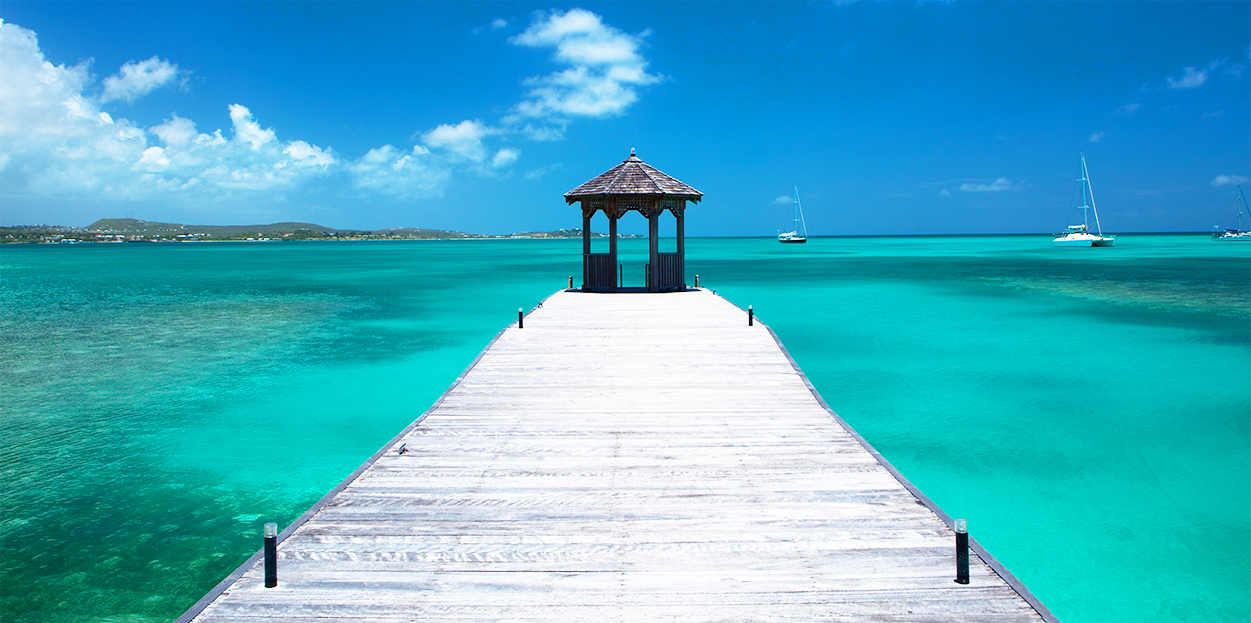 Dock leading out into the ocean at Jumby Bay Resort, Antigua