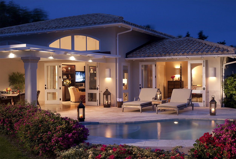 View of a pool and private villa at Jumby Bay Resort, Antigua