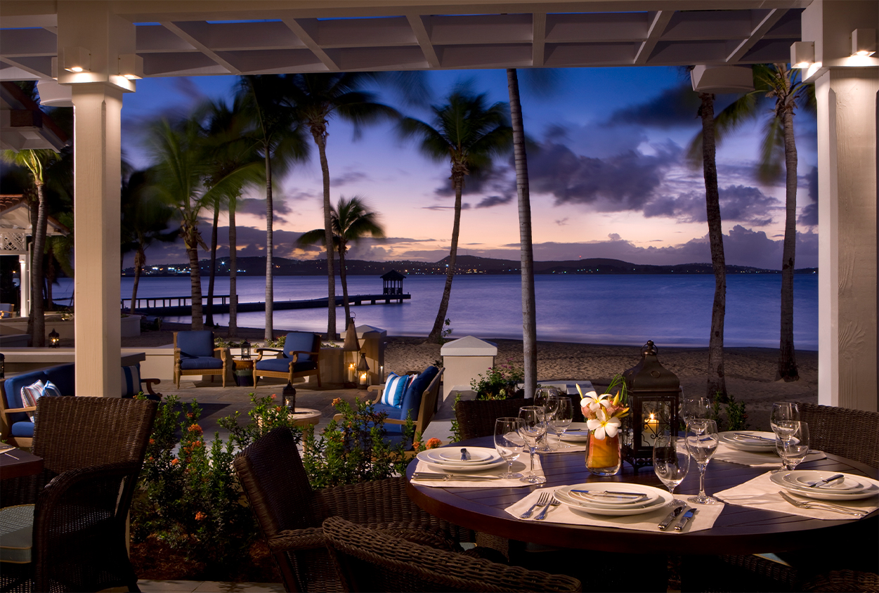 Outdoor dining by the beach at Jumby Bay Resort, Antigua