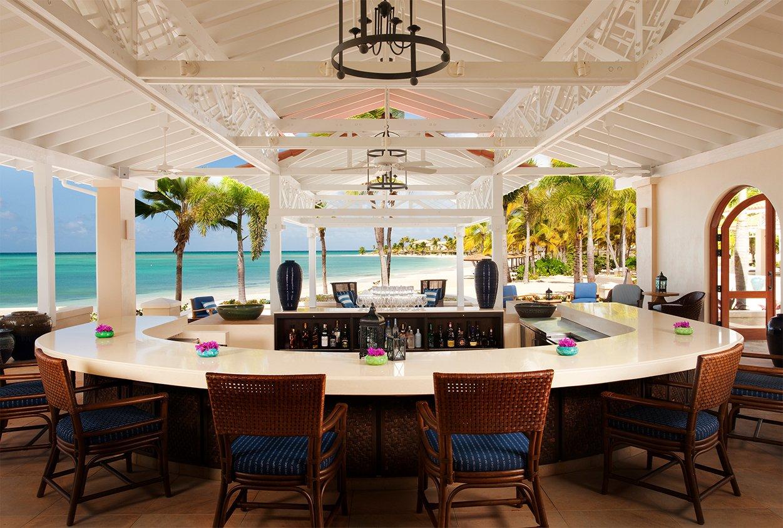 Outdoors bar by the beach at Jumby Bay Resort, Antigua