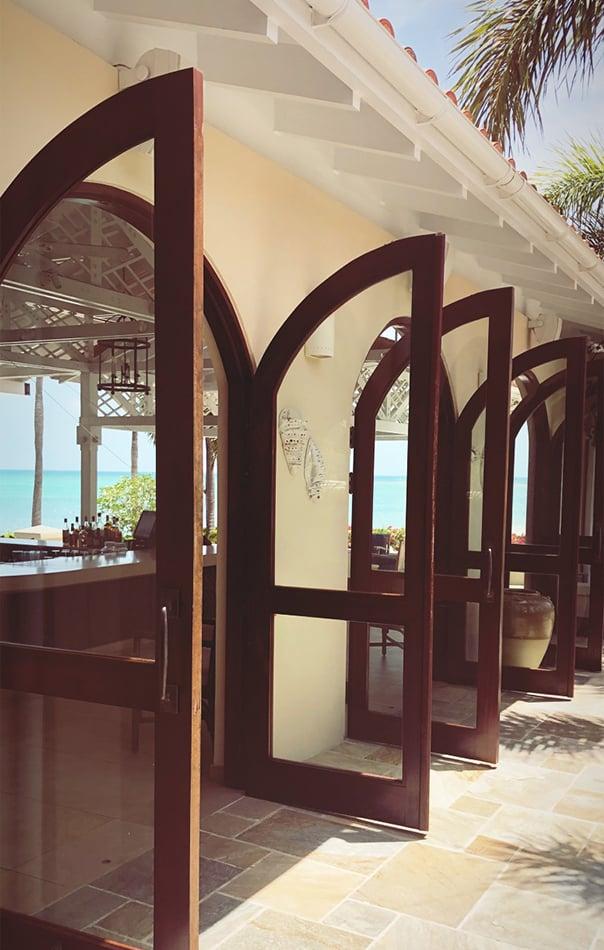 Open doors for an outdoor bar near the beach at Jumby Bay Resort, Antigua
