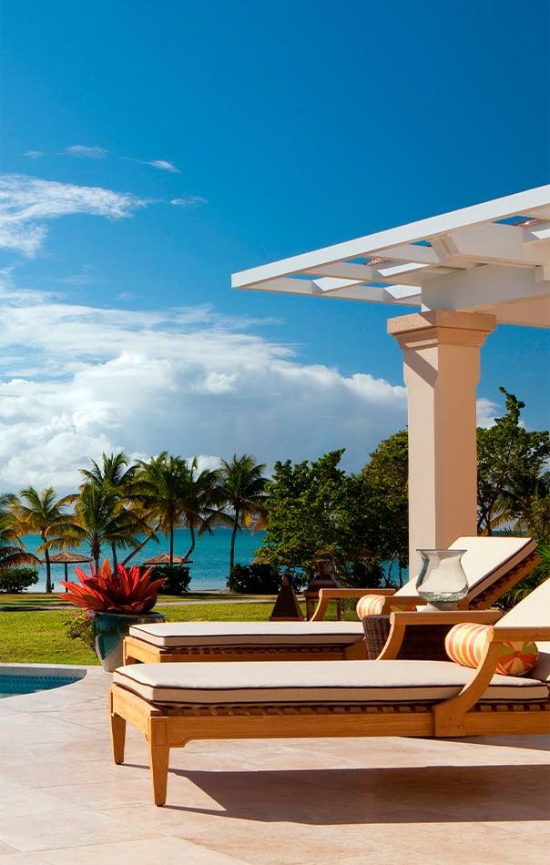 Poolside seating at Jumby Bay Resort, Antigua