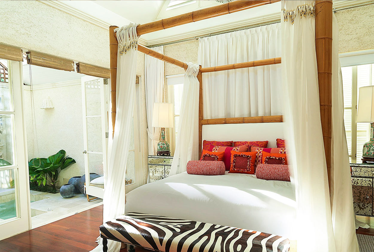 Canopy bed next to outside hot tub at Roaring Pavilion, Jamaica