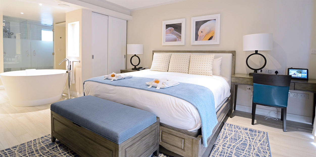 Bed in the same room as a bathtub at The Body Holiday
