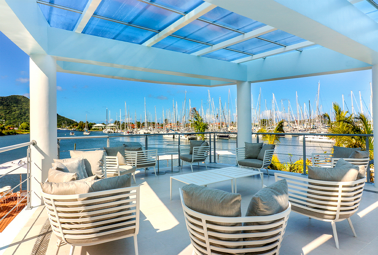 Outside seating overlooking the water at The Harbor Club