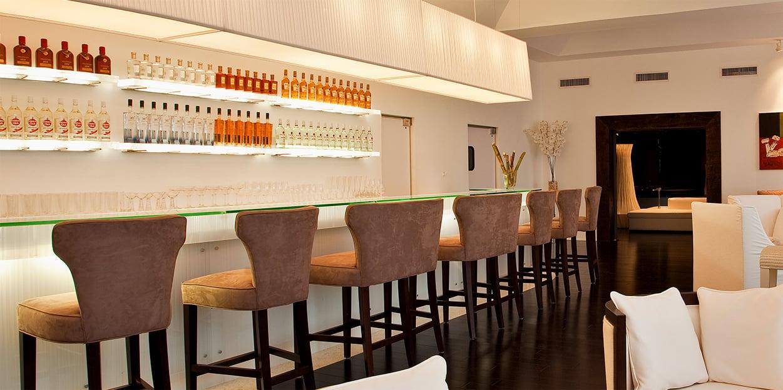 Bar and seating area at Viceroy Sugar Beach
