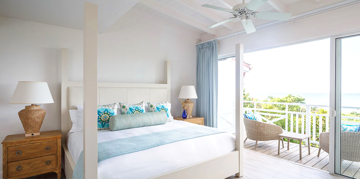 Bed and balcony at Windjammer Landings