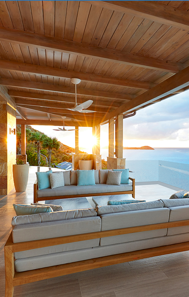 Great Room Terrace with teak furniture and sunset