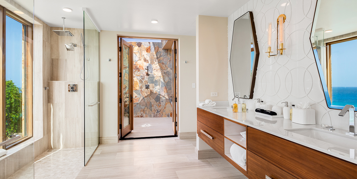 Luxury bathroom with double sink floating vanity and double shower