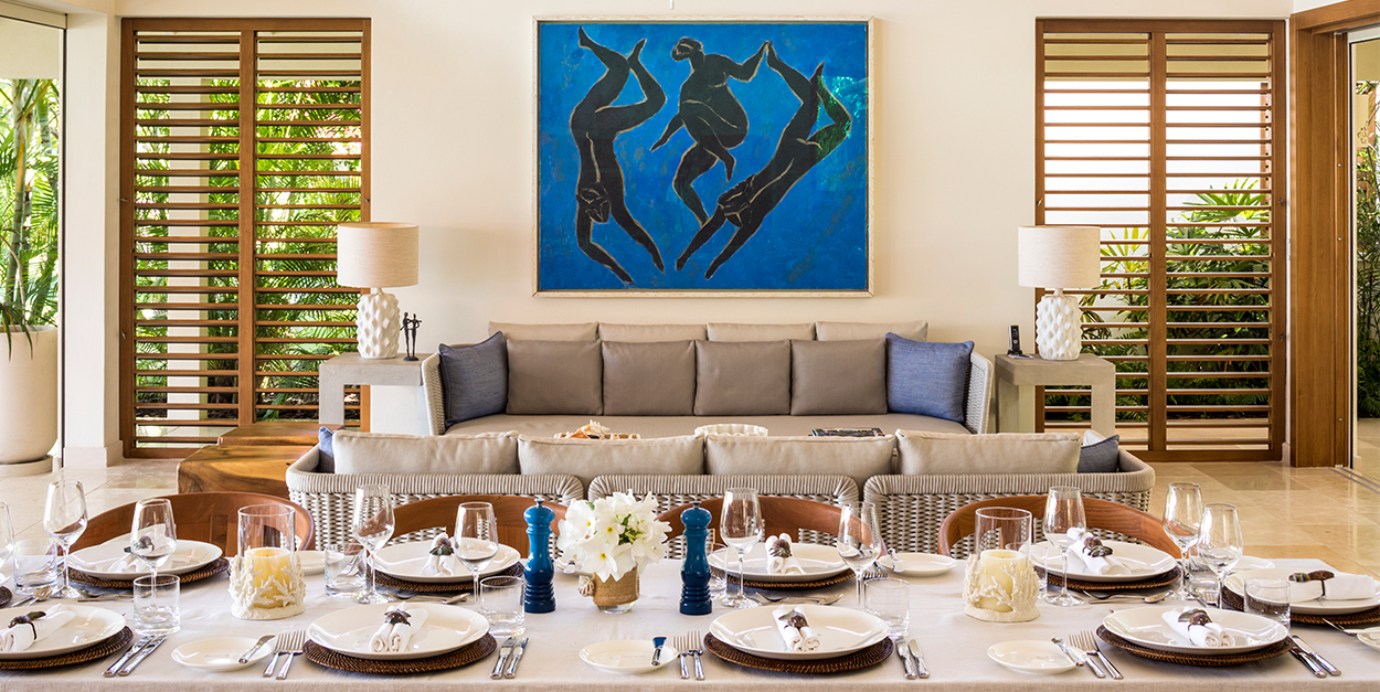 Great room dining with table setting and original artwork