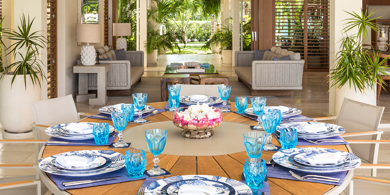 Outdoor Dining and great room with table setting in blues