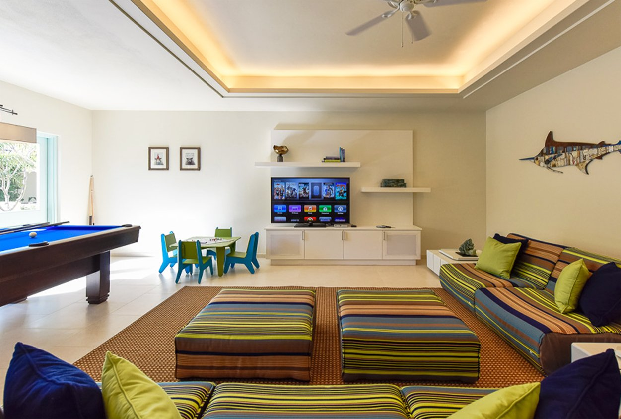 Indoor gaming area in Private Estate Home in Jumby Bay
