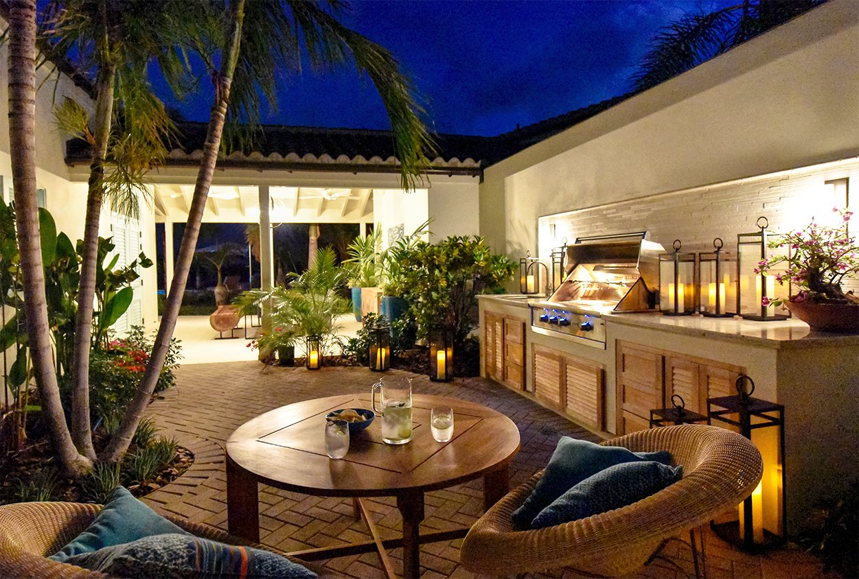Outdoor grill and seating at night in Private Estate Home in Jumby Bay