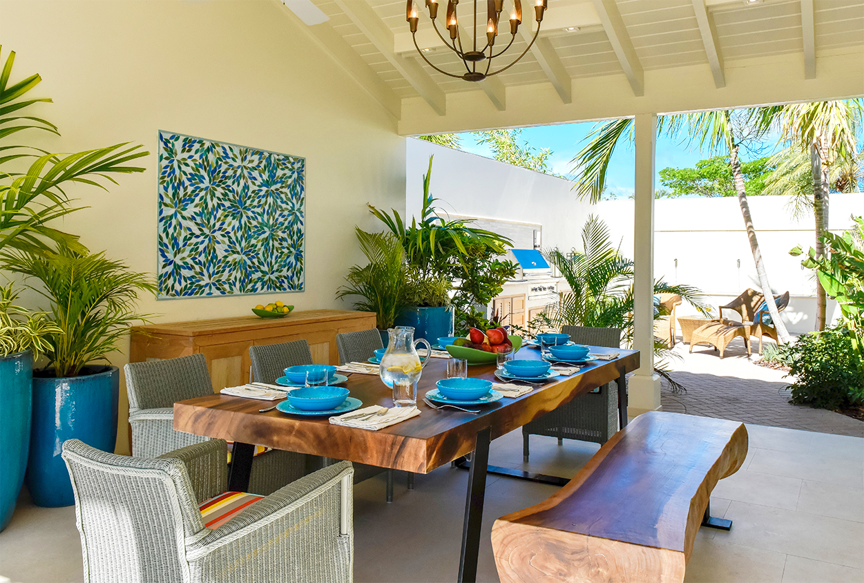 Covered outdoor dining area in Private Estate Home in Jumby Bay