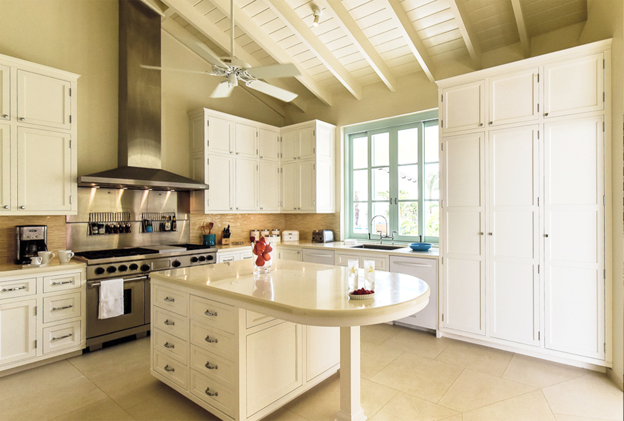 Kitchen with an island in Private Estate Home in Jumby Bay