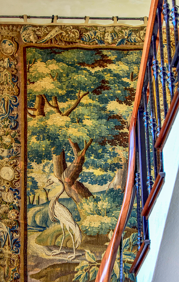 Staircase and tapestry in Jumby Bay private estate