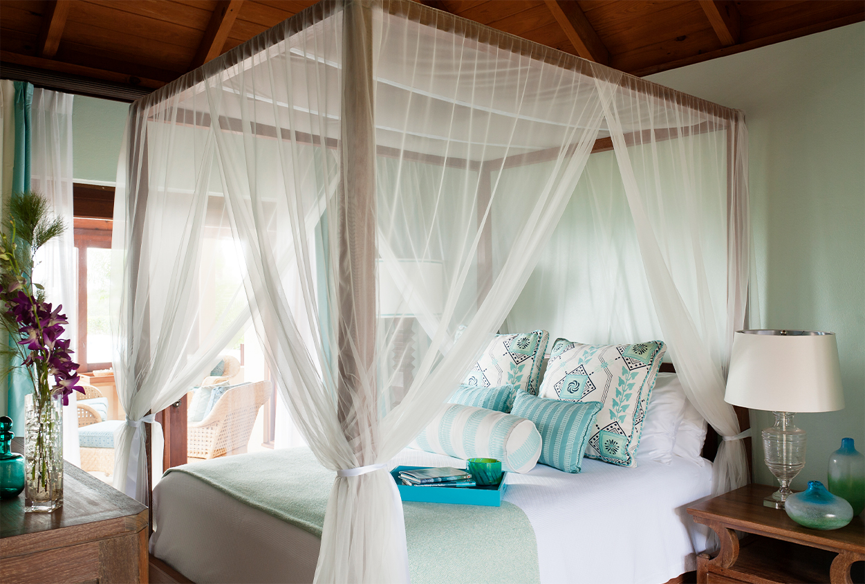 Canopy bed next to a porch area in Tamarind Cove