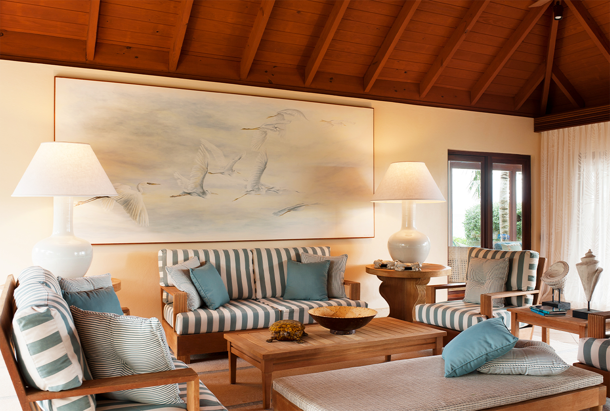 Seating area with a large bird painting in Tamarind Cove