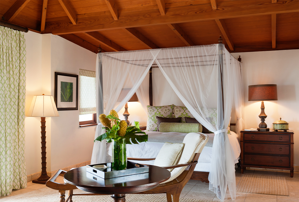 Bedroom with a canopy bed in Tamarind Cove