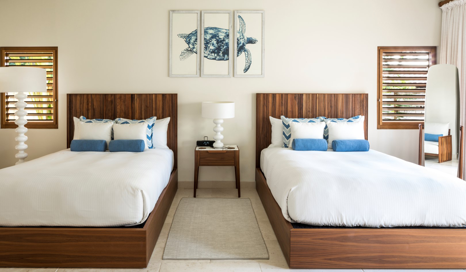 Bedroom with two beds and custom turtle artwork