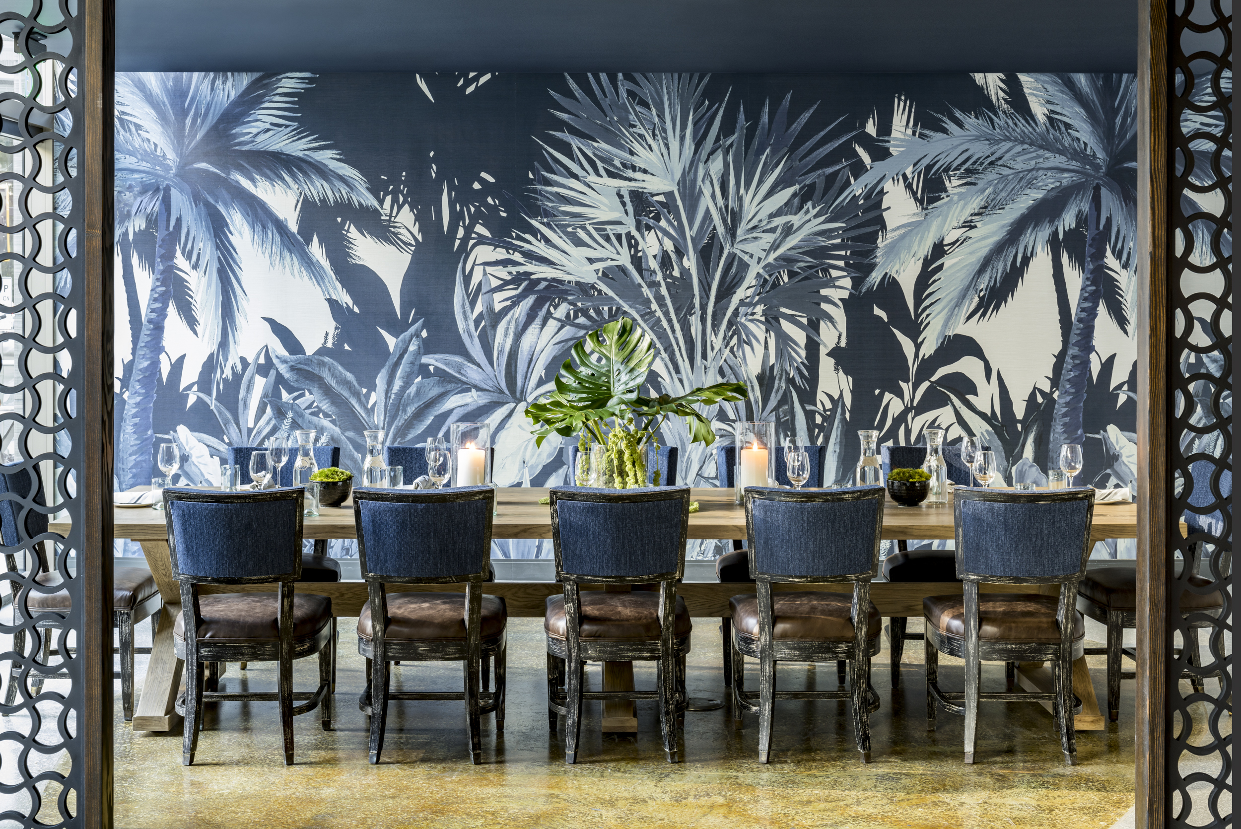 River Oyster Bar Private Dining Room with wallpaper and blue chairs